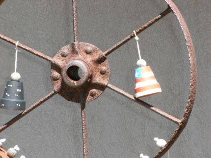 I came across a rusted wheel wind chime recently at the entrance of a local plant science center.