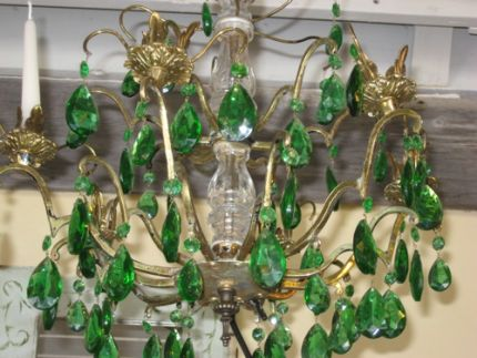 This is a chandelier that I found that had no wires so i added the green crystals and candles.