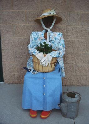 This garden gal will be sitting outside my shop to welcome guests to my next sale -- my new business partner of sorts.  Some of the guys in the neighboring units arent too sure about what Im doing -- this will seal the deal!