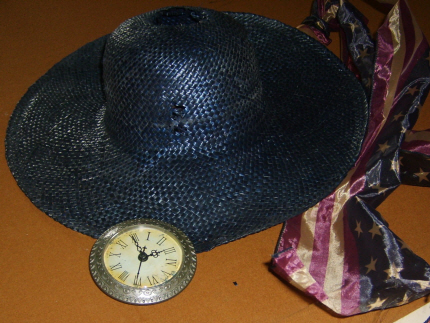 3 basic components, clock works left from another project, a patriotic gift ribbon, and a straw hat from when I actually wore them as a fashion accessory!!