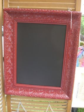 Nothing fancy.  Just a simple, quick fix for a rummage sale find.   I painted it red and used chalkboard paint.