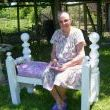 My sweet 84 yr. old neighbor on the bench we built for her birthday.