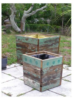 A plant in dire need of room to grow and a stack of old dock boards inspired my husband, Joe, to build some pretty fabulous rustic planters!