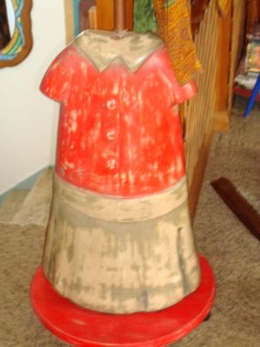 I found this ceramic figure of a little girl at an antique/junk store a year or so ago, and although I had no idea what Id do with it, I had to have it. She is about 2 1/2 feet tall, and hollow. I discovered that when I drilled a hole through her!