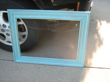 This is an old frame given new life with a coat of aqua paint and then distressed.