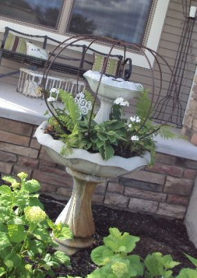 This is a new bird bath I purchased last year.  I just added the farm piece over the top.  Im not sure what it was used for, but its sure a cool piece!