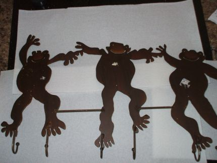 Goodwill find, turned Garden Art. Are they Frogs or Monkeys?