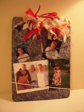 Of course it can be used as a regular  clipboard but it now makes a good display board for photos. I stretched a few elastic bands around it so I could put in a few more pictures.