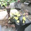 My patio table set with a vintage picnic basket, an old iron fireplace piece and a tin watering can filled with yarrow.