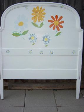I painted this bed for my friends 2-year old.  Ruthie loves her big girl bed.  The flowers match her bedding.