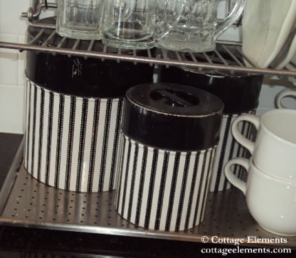 I found these vintage B&W canisters at an occasional sale and they were very inexpensive.  Pairing them up with white cups, glass and stainless makes a perfect compo.  And guess what?  No color!