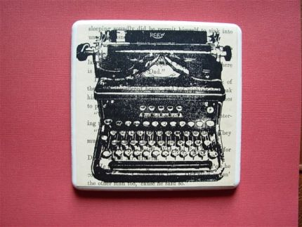 I stamped an image of a vintage typewriter on the page of an old book.