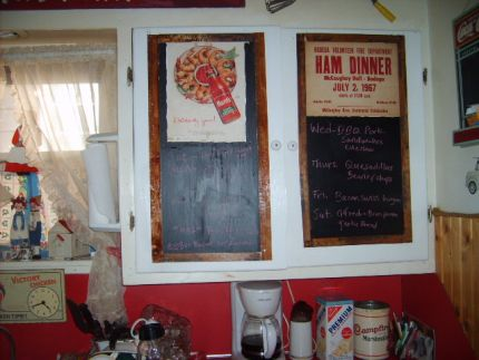 stained rulers border old cardboard signs and black chalkboard paint on my kitchen cupboards