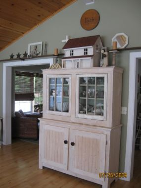 This was our first Junk Project.  My husband and I were married back in 2000...we found these windows for cheap while driving around on our honeymoon.  We thought theyd make great doors for a hutch to display all of the pretty dishes wed just received as wedding gifts...my favorite kind of souvenir :)