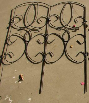 This is a metal fence panel I used to keep my kids out of my flowers. ;) I have 6 panels and they are 32 tall x 24 wide.