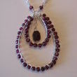 This is a sterling silver and faceted garnet necklace I hand wire wrapped and also formed the loops by hand.  All new elements though.  This is something I did a few years back.