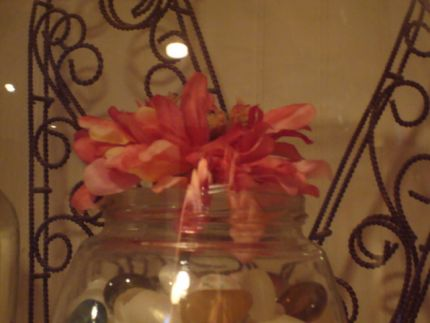 I couldnt wait to get home and tear out the plastic christmas stuff that the lady I bought it from thought was such a wonderful bonus! I had this pretty shaped old jar which I filled with white shells and earth toned glass beads. One silk flower gave it just a little color.