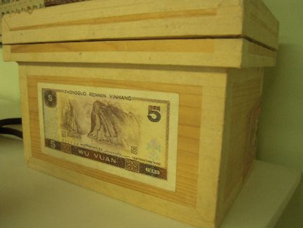 Left the tea box in its nakedness to match the muted colors of the currency...