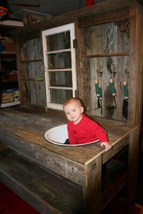 Potting table my husband made. He builds them and I design them. My niece is in the pic for fun!