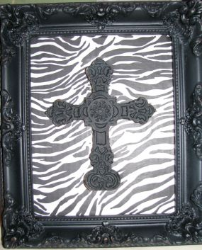 After: Used a little soap/water.. and a Q-tip to clean up this wooden frame and painted it distressed black. Decopauged the animal print  and added a metal cross from HLs 1/2 off sale! Couldnt be happier!