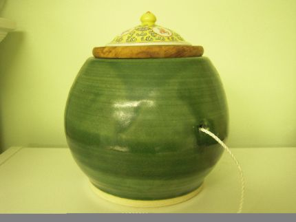 I call this my Chinese moon melon... I just love the shape and the green glaze.