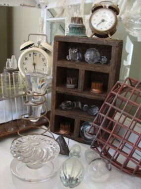 Well...flower frogs, bottle stoppers, clocks, a rusty spring,  bottles (and glass cigar tubes)...did I forget anything?