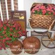 Mixing old and new for an outdoor display.  Dont you love this basket?  It is perfect for fall flowers.  My mom got the bench for free and I found the metal pumpkins at Habitat Restore.  They dont mold.  I got the sign a couple of years ago and I just got the wheel on clearance at Michaels.