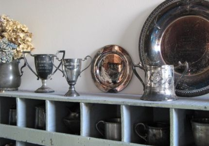 We found this great cubby in North Carolina. Its perfect for fun silver pieces -- tropies, baby cups, even a high school award tray