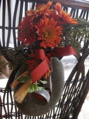 I used these as chair back decorations, but they could be just as easily hunk on a door knob or a wall. For Thanksgiving I flipped the applique to the back and placed the unadorned side facing out. I filled the canteen with water and added fall florals.
