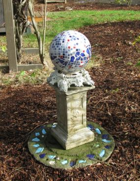 This piece has four elements: the bottom base, the pedestal, the metal part, and the globe.