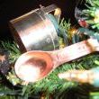 Copper measuring spoons and stainless steel biscuit cutters were added to round out the decoration.
