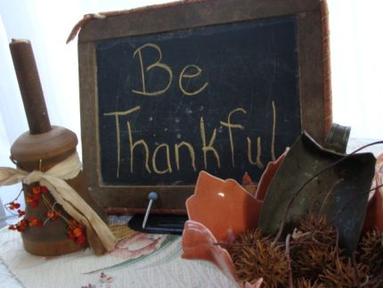 An antique chalkboard - all raggedy and well used.  The wooden candle holder was made just for me by my friends at The Bittersweet Cabin...  Im so thankful for good friends!