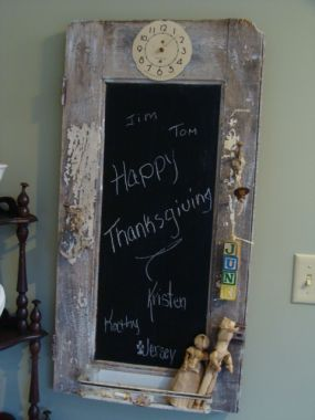 Happy Thanksgiving!  From my family to yours!  I took an old cabinet door and used chalkboard spray paint in the panel, added a couple old coat hooks to hang some junk, and a metal rack on the bottom.  (Taking it to the show tomorow!!)