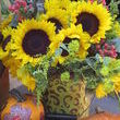 Outside or in this bucket of sunflowers is a delightful fall display.