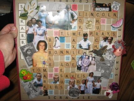 I took an old scrabble board..added family related pictures and trinkets..spelled out with scrabble tiles, family names and info. Made a hanger ...was a gift for my mother-n-law who adores the Scrabble game.