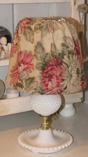 A simple vintage fabric slipcover just to change the look.