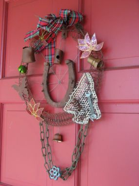 A rusty wreath decorates the front door. I learned how to make these thanks to all my friends at Junk Market Style!