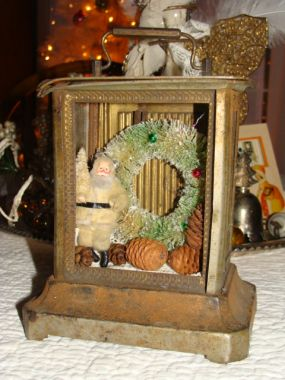 An old metal (rusty) clock case - a perfect spot for a little Christmas vignette.  And, I just stuck things in it, so I can easily pull it out and redecorate!