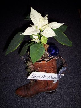 Several years ago, my large extended family agreed all Christmas gifts must be garage sale, thrift store or home made. This is what my niece got this year.  My sister got the other one.  After the poinsettia dies down it can be snipped off. The boot is planted with assorted sedum and bulbs.