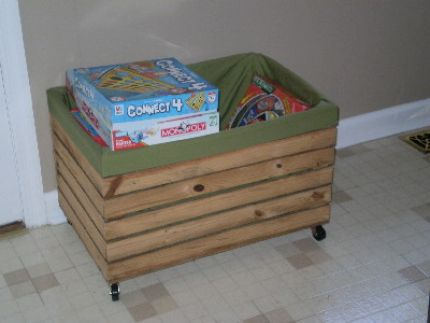 I found this old crate at a yard sale, sewed a simple lining and added wheels!  We use it to hold board games and can wheel it into the dining room, living room, playroom, etc.!  I can see many uses for this idea...great storage & I like the wheels!