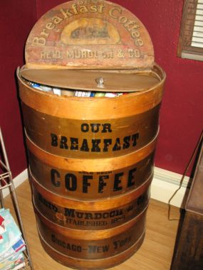 Its that time of season when we need to look for ways to store wrapping paper. We bought this coffee bin mainly because we like old advertising. But my husband looked at it and said you know I think  all your rolls of Christmas paper would fit in it.