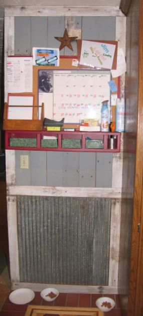 This is the wall in the kitchen that we covered with dairy parlor wood and tin, shiny side out..This calender was also made of scrap wood and keeps us organized.