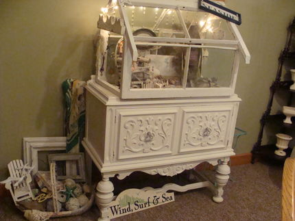 Everything is turning to fall...the weather, leaves, decorating, etc. - but thought Id share one of my last glimpses of summer - my conservatory... The sideboard that it sits on was a garage sale find - $10!  It was love at first sight!!  (and a white paint job of course!)