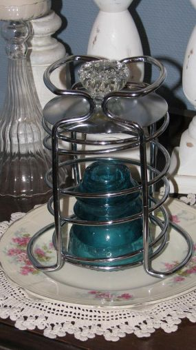 This if my favorite way to use this piece. Add a glass door knob for the top of the cloche and display a glass insulator. All served up on a pretty plate.