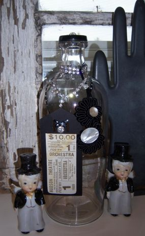 This vintage bottle is ready for an evening out.  It even has a theater ticket!  The little tuxedo salt and pepper shakers were found at a yard sale the same weekend I got the bottle.  I think they must have subconsciously inspired my theme!