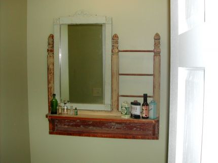 Antique commode or dresser top accenting our bathroom wall