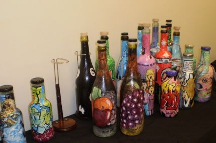 These are some of my finished bottles.  I also chilled and filled a few with lemonade and punch and put them on my table as festive Christmas containers.