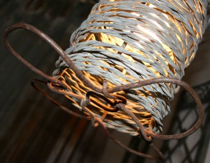 Here's a pendant lamp I made out of an old barbed wire spool.
