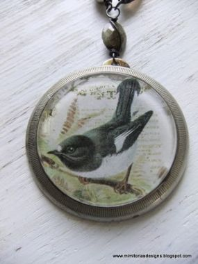 Bird is the front side of the necklace focal.