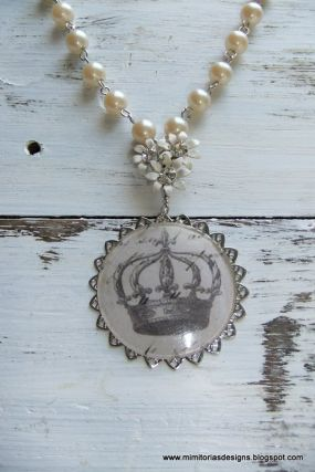 Crown, vintage enameled jewelry element and a strand of vintage glass faux pearls are all used to create this necklace.  The silver toned filigree and sterling silver clasp are new elements. A necklace for the Queen.